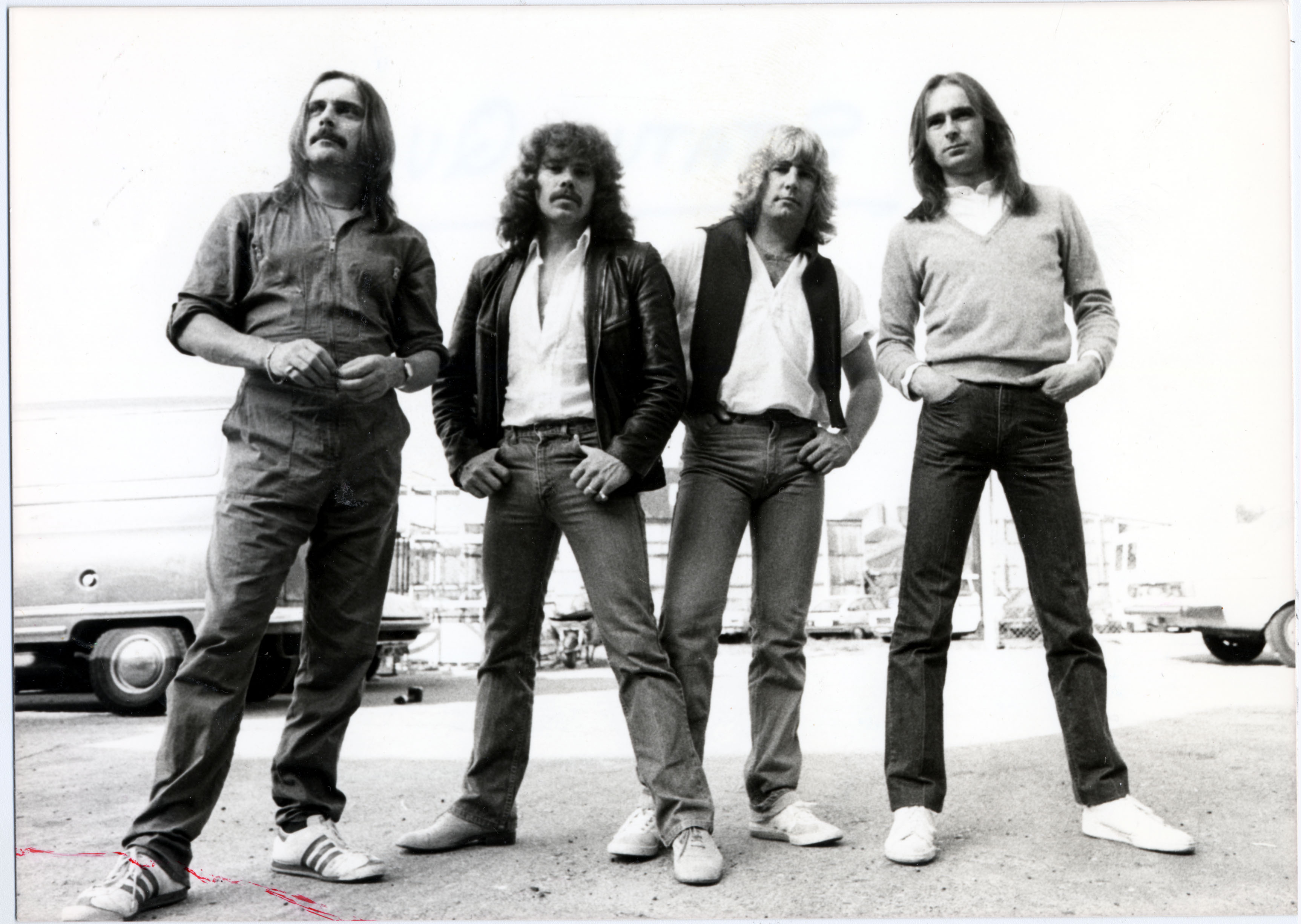 Status Quo pop group. Picture shows Rick Parfitt and Francis Rossi with other members of the group