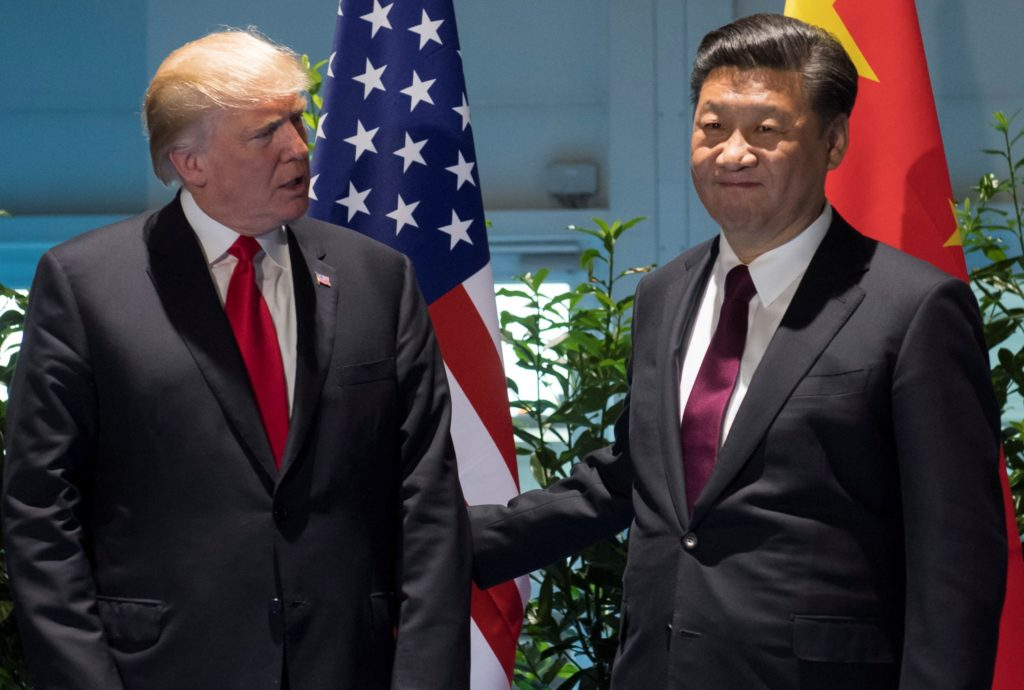 U.S. President Donald Trump and Chinese President Xi Jinping (R) meet on the sidelines of the G20 Summit in Hamburg, Germany, July 8, 2017.  REUTERS/Saul Loeb, Pool - RC1EBFD46E60